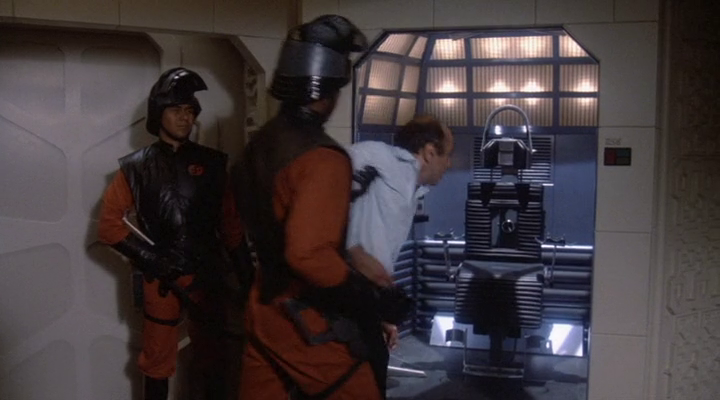 person being forced to enter an operating chamber by strawman fascist aliens that actually behaves like communists